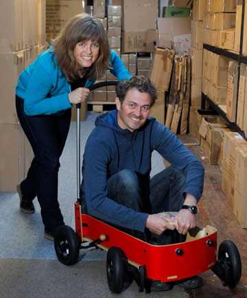 HAVE WHEELS, WILL TRAVEL: Wishbone Design Studio partners  Jennifer McIver and Richard Latham with the toy company's Wishbone Wagon which transforms from a pull-along trolley to a go-kart, then a car.