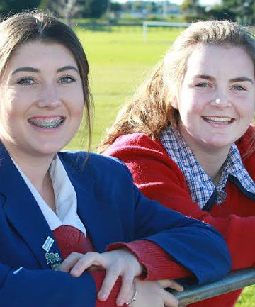 Pride of the south: Southland Girls' High School students Kloe Milne, left, and Lucy McIntyre are in teams at the International Friendship Softball Series in Sydney