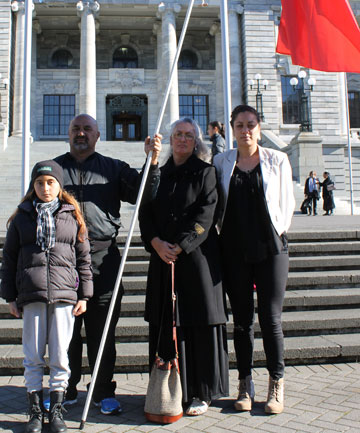 STANDING UP: Robbie Taylor, with daughter Krista Taylor in front, and Andrea Moore, with her daughter Marama Moore, travelled to Parliament to protest against Te Ataiwa's initialling of its deed of settlement with the Crown on June 4.
