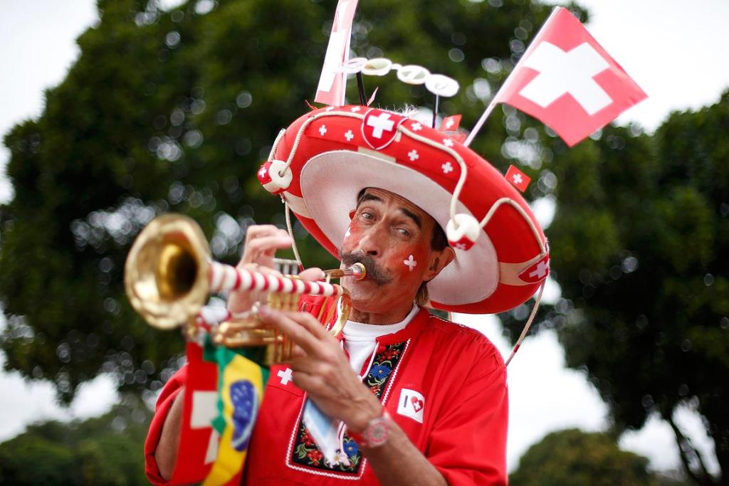 A Switzerland fan arrives at the National stadium to watch his team play Ecuador.