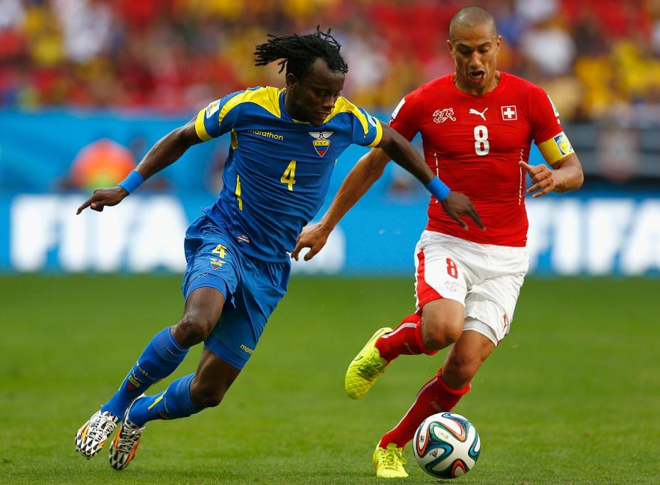 Gokhan Inler of Switzerland controls the ball against Juan Carlos Paredes of Ecuador.