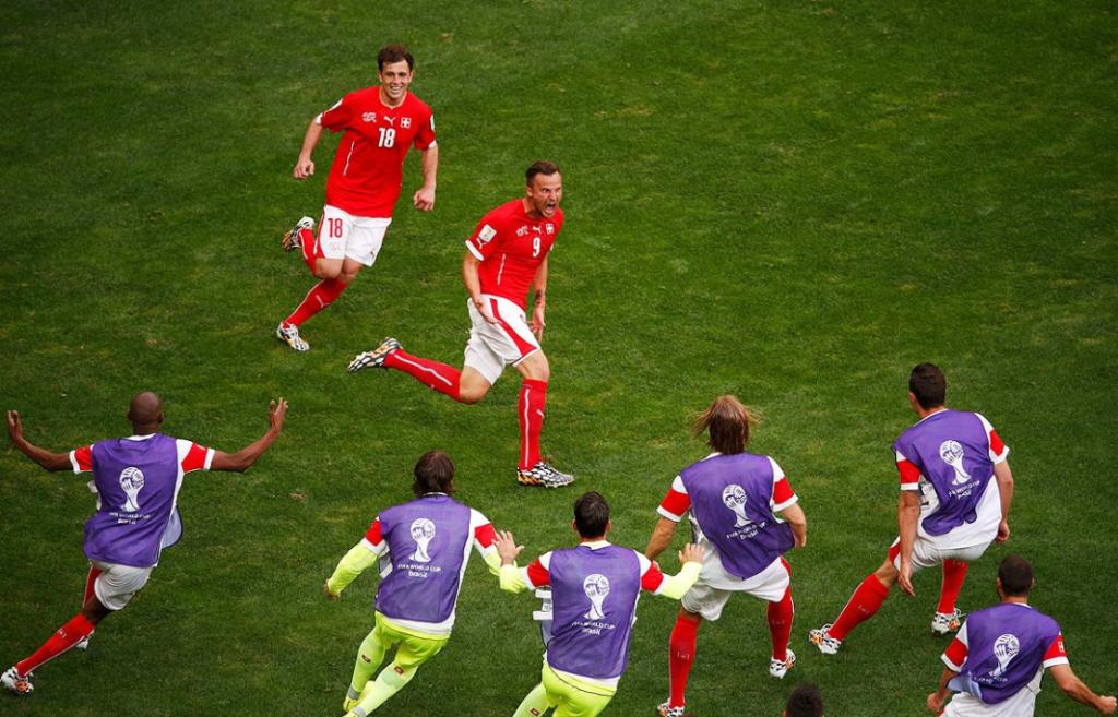 Switzerland's Haris Seferovic (9) celebrates his goal against Ecuador with his teammates