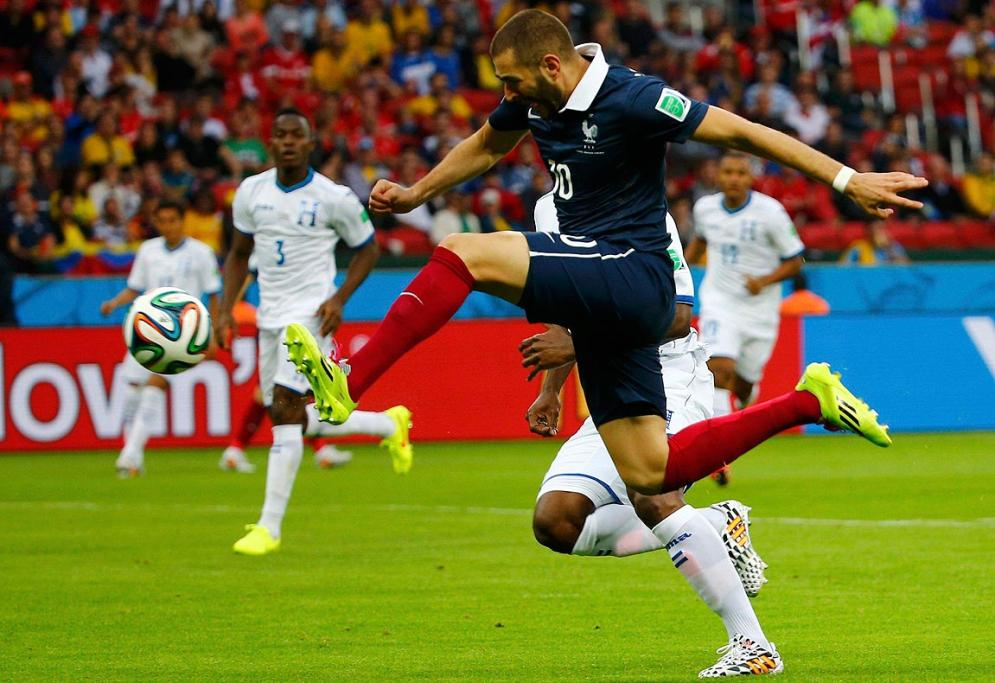 France's Karim Benzema shoots to score during the Group E match between France and Honduras.