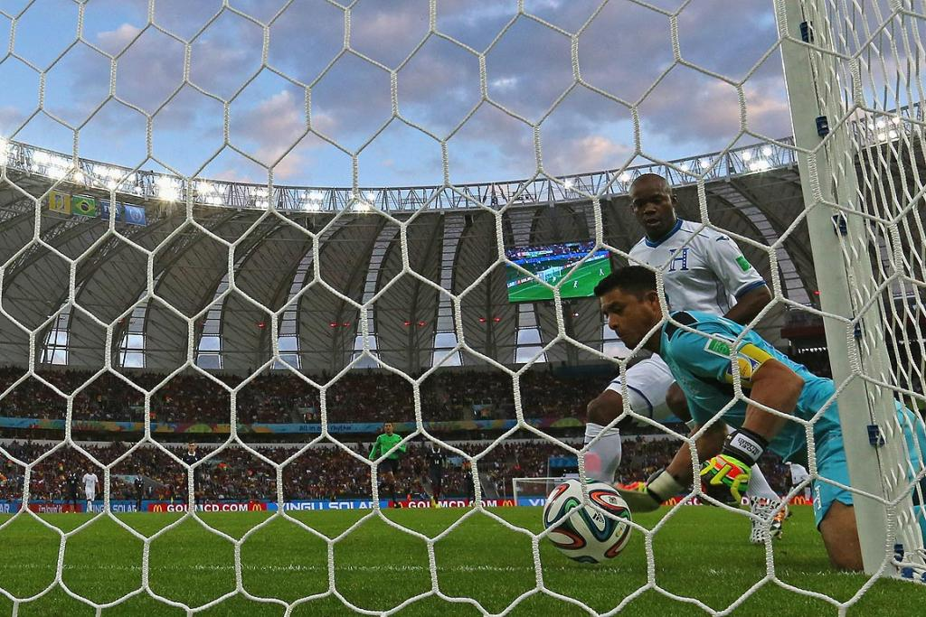 Goalkeeper Noel Valladares of Honduras scores an own goal, France's second, as he fumbles the ball over the line during the Group E match between France and Honduras.