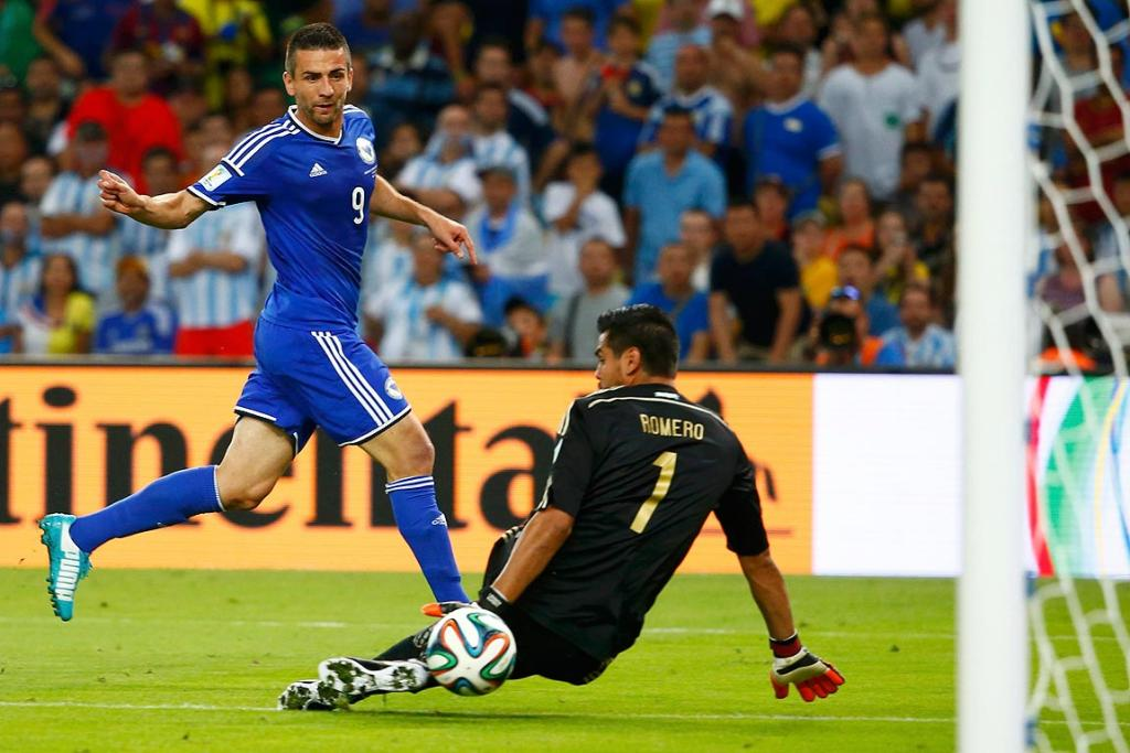 Bosnia-Herzegovina's Vedad Ibisevic scores through the legs of Argentina's Sergio Romero.