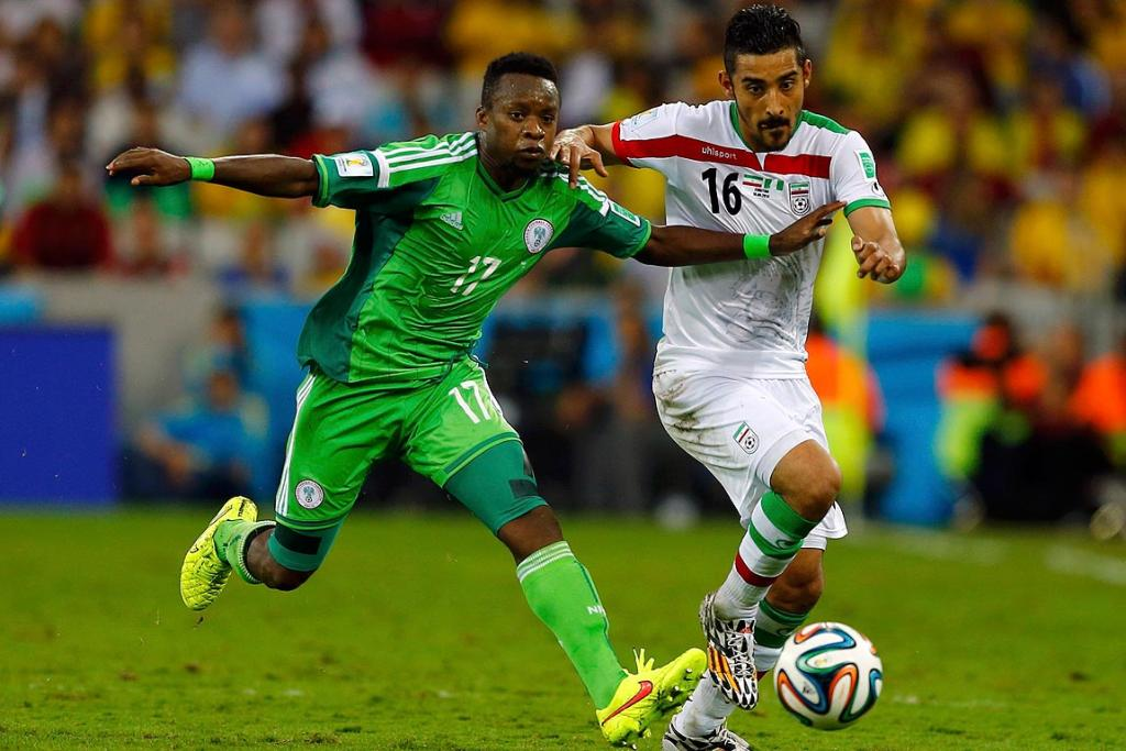 Nigeria's Ogenyi Onazi fights for the ball with Iran's Reza Ghoochannejhad.