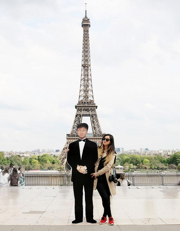 In front of the Eiffel Tower, Paris, France.