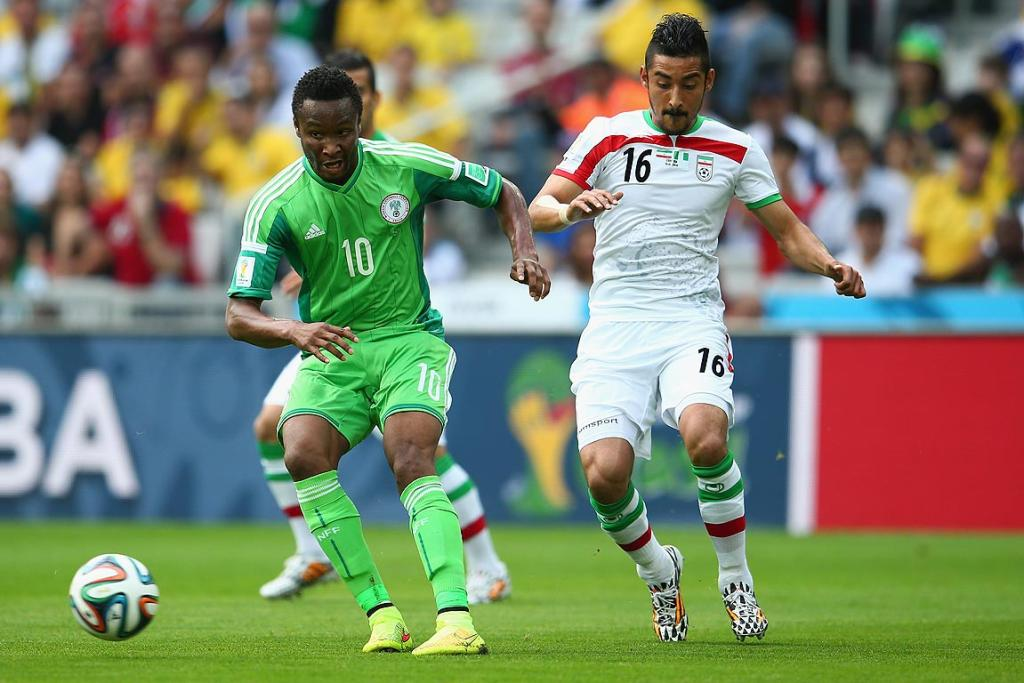John Obi Mikel of Nigeria controls the ball against Reza Ghoochannejhad of Iran.