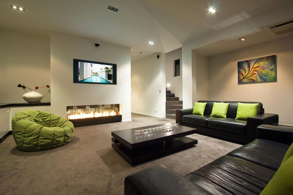 The house has many hi-tech features, like this modern fireplace.
