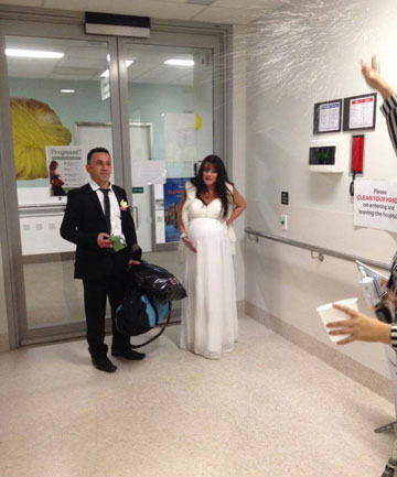 HONEYMOON DRAMA: Mario and Liz Shlimon arrive at Wellington Hospital's maternity ward just after their wedding on June 6.