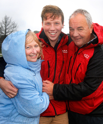 HUG FOR A HERO: Head boy and Part-time hero Angus Pauley pictured with his proud parents Helen and Gary Pauley at the High Street Bridge where the river rescue drama unfolded.