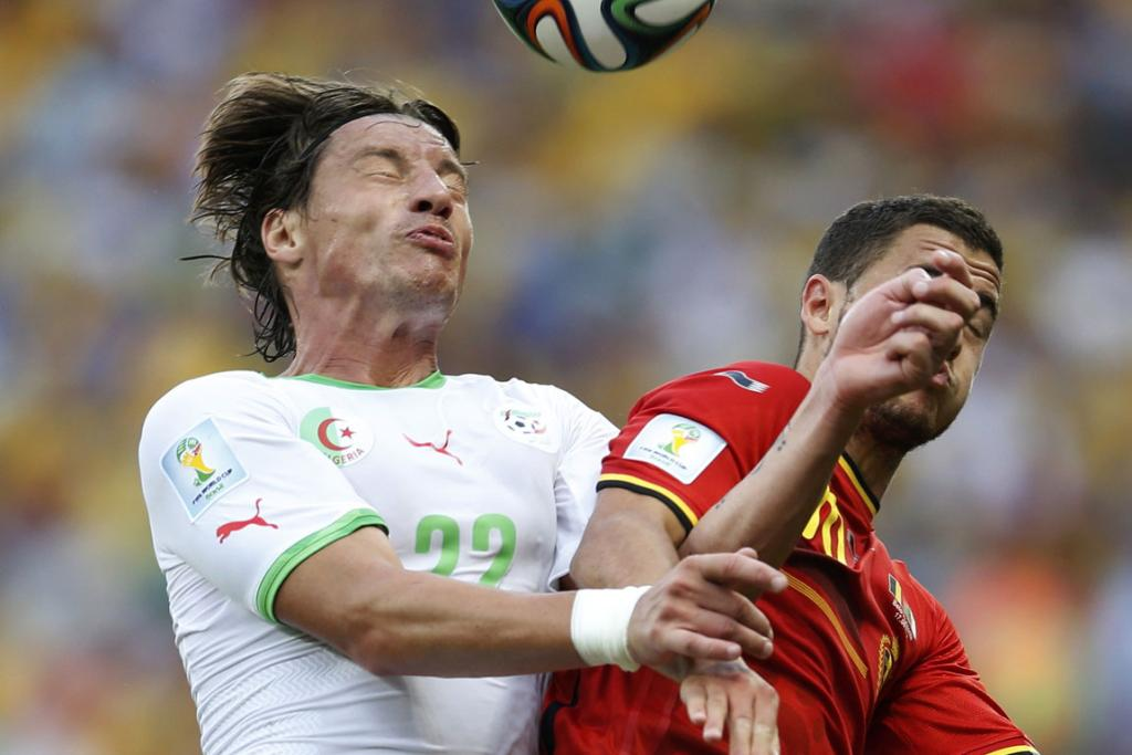 Algeria's Mehdi Mostefa, left, fights for the ball with Belgium's Eden Hazard during their World Cup Group H football match at the Mineirao stadium in Belo Horizonte, Brazil.