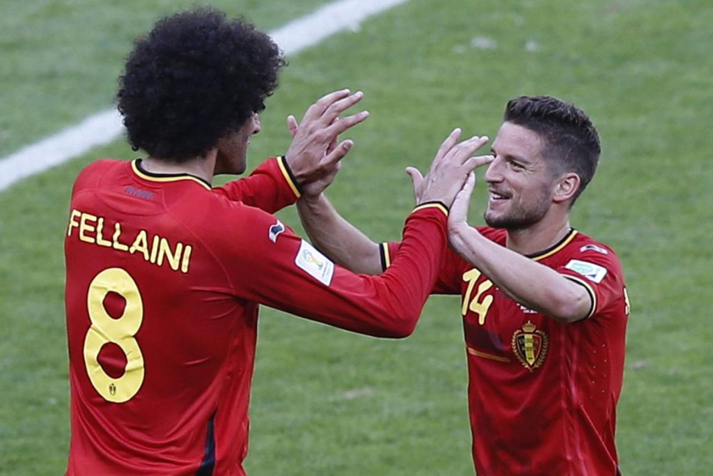 Belgium's Marouane Fellaini, left, and Dries Mertens celebrate after their World Cup Group H football match against Algeria at the Mineirao stadium in Belo Horizonte, Brazil.