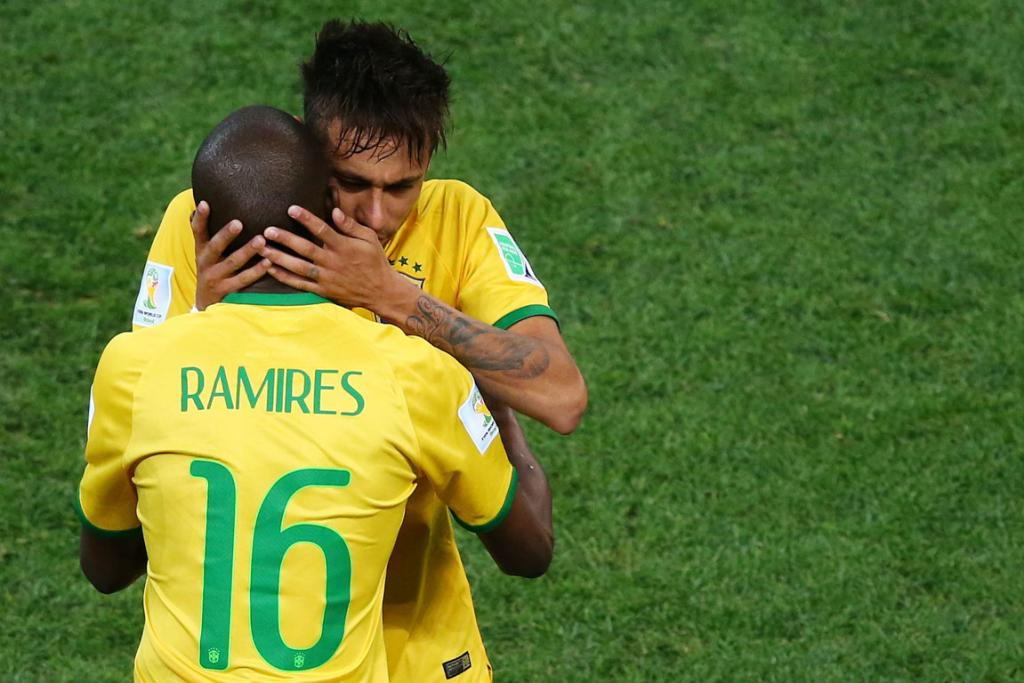 Brazil forward Neymar (R) embraces teammate midfielder Ramires after he was substituted during the Group A football match between Brazil and Croatia.