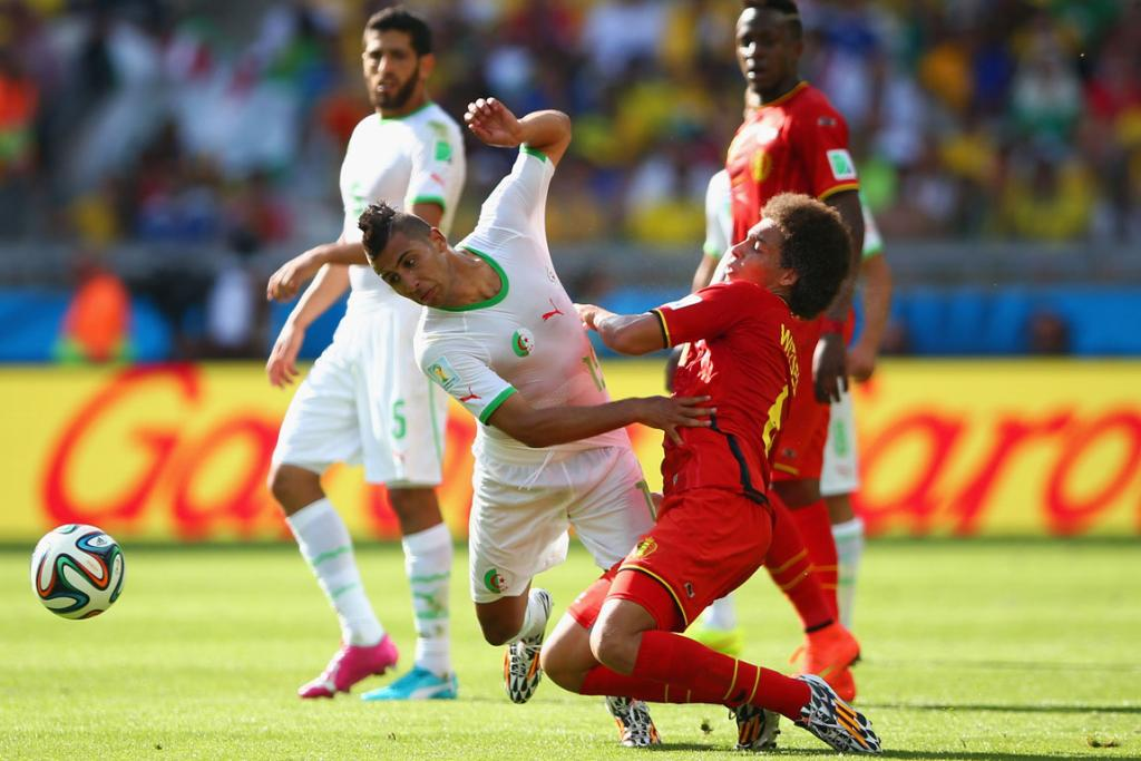 Saphir Taider of Algeria and Axel Witsel of Belgium compete for the ball during their World Cup Group H match at Estadio Mineirao in Belo Horizonte, Brazil.