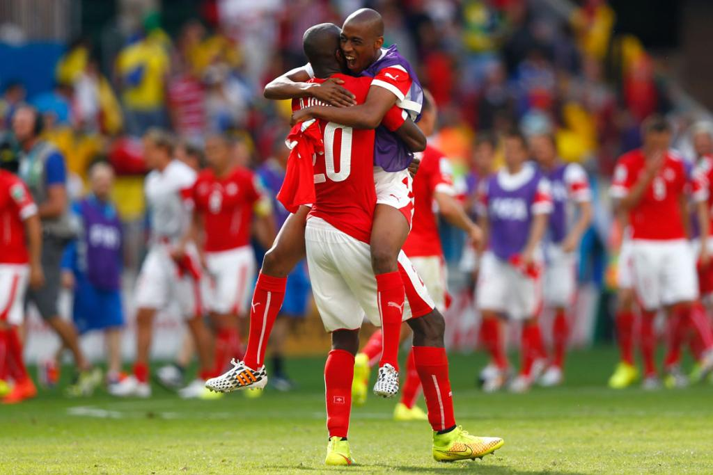 Johan Djourou of Switzerland celebrates with team-mates after the match between Switzerland and Ecuador.