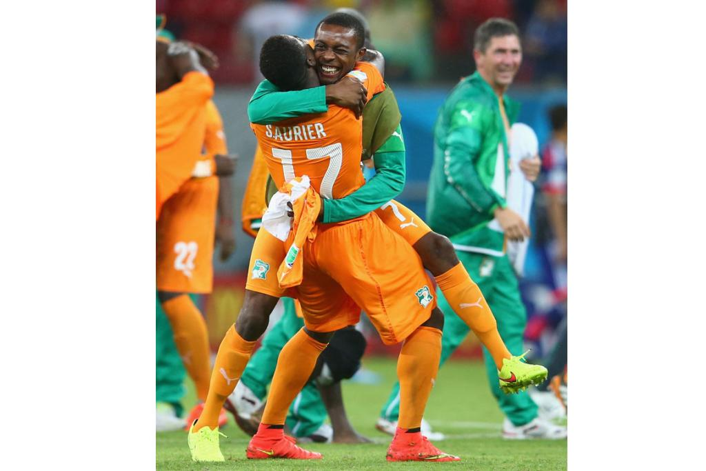 Serge Aurier (L) and Jean-Daniel Akpa-Akpro of the Ivory Coast embrace after defeating Japan 2-1.