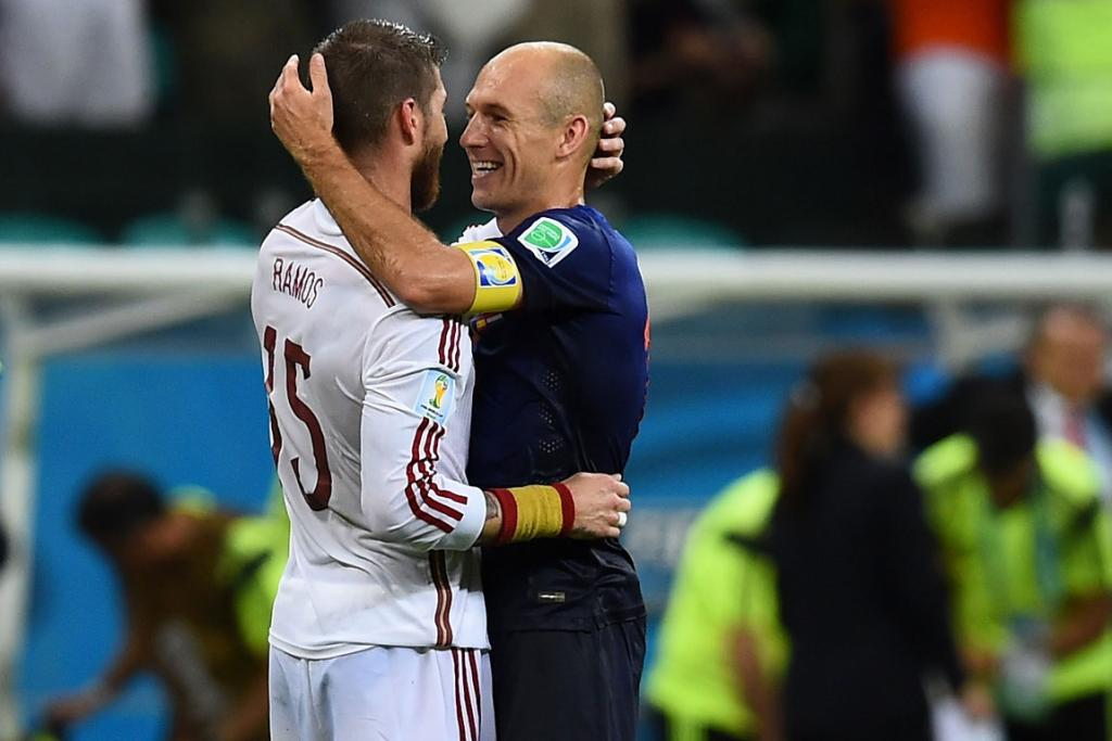 Sergio Ramos of Spain and Arjen Robben of the Netherlands take a breather from their rivalry to enjoy a moment together.