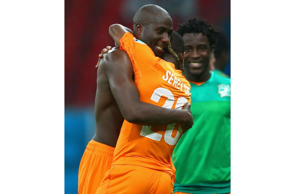 Sol Bamba of the Ivory Coast (L) hugs teammate Die Serey after defeating Japan 2-1.