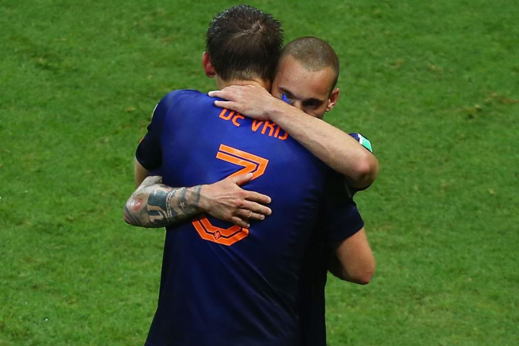 Stefan de Vrij and Wesley Sneijder of the Netherlands embrace after the third goal during the match between Spain and Netherlands.