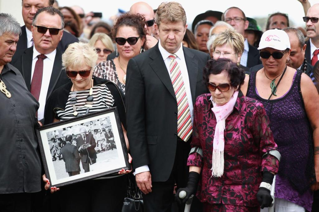 Labour MP Annette King (left), carrying a 40-year-old photo of former Prime Minister Norman Kirk at Waitangi, Opposition and Labour leader David Cunliffe and Titewhai Harawira (right) arrvie at the Te Tii Marae on February 5, 2014 in Paihia.