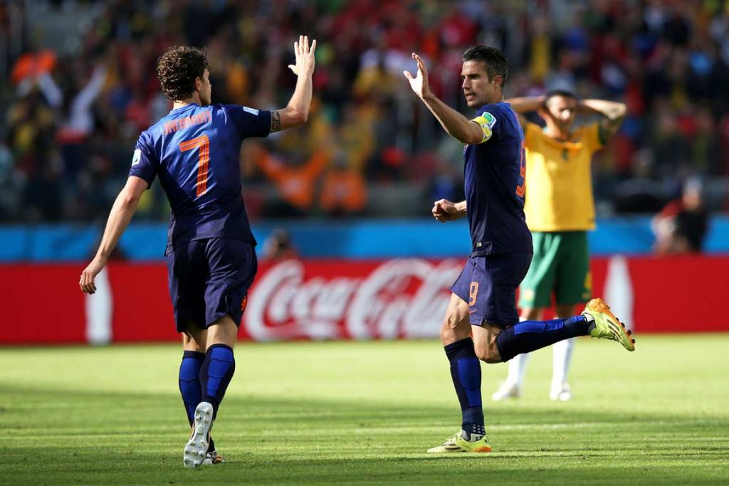 Robin van Persie high-fives Daryl Janmaat after scoring the Netherlands' second goal.
