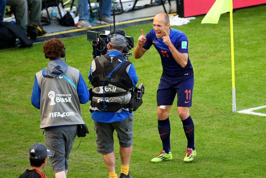 Dutch midfielder Arjen Robben gestures to a TV camera after scoring his third goal at the World Cup.