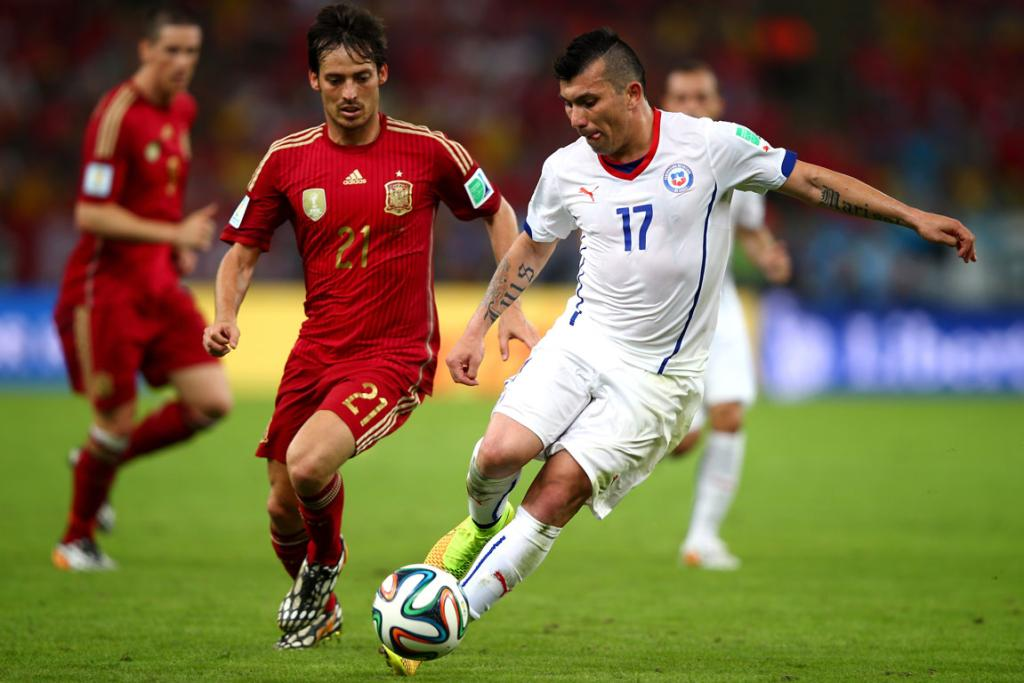 Gary Medel of Chile controls the ball against David Silva of Spain during their World Cup Group B match at Maracana in Rio de Janeiro, Brazil.