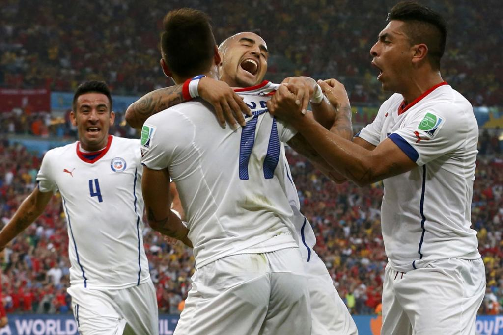 Chile's Mauricio Isla, Eduardo Vargas, Arturo Vidal and Gonzalo Jara (left to right) celebrate after their first goal during their World Cup Group B football match against Spain at the Maracana stadium in Rio de Janeiro, Brazil.