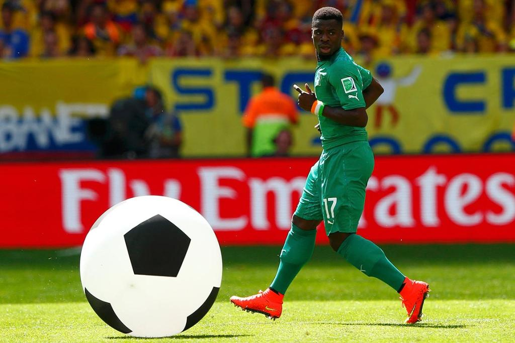 Ivory Coast's Serge Aurier runs towards a big ball during the Group C match between Colombia and Ivory Coast.
