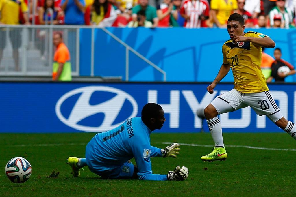 Colombia's Juan Quintero scores his team's second goal past Ivory Coast's goalkeeper Boubacar Barry.