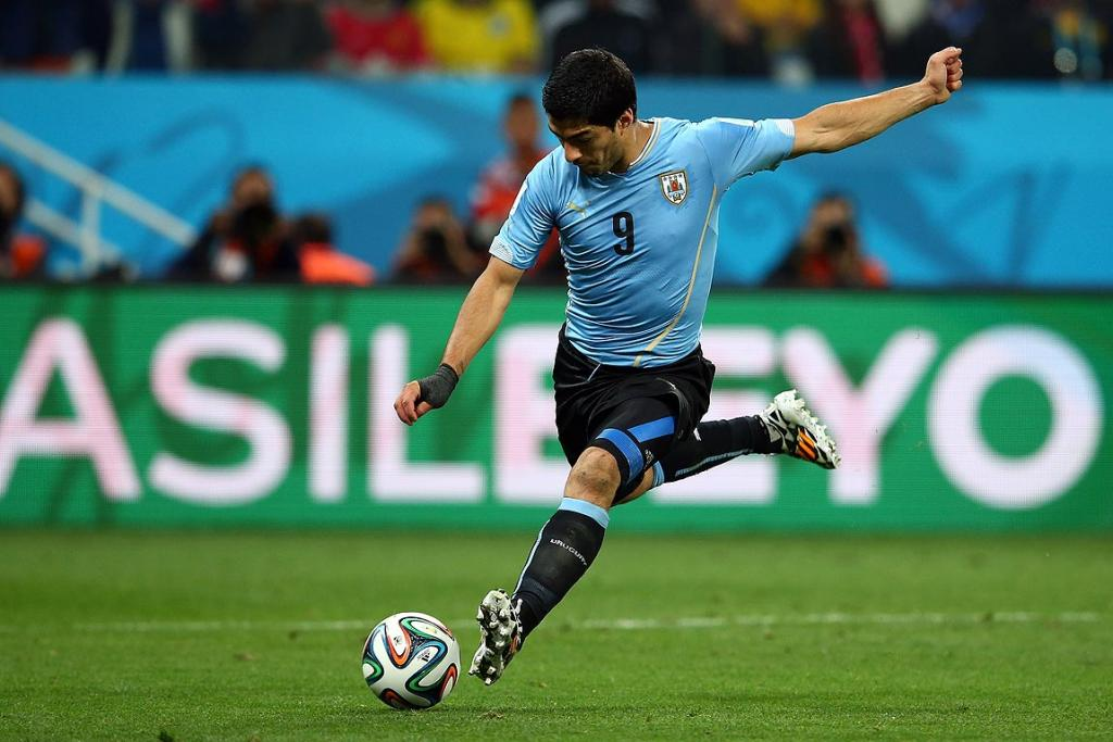 Luis Suarez of Uruguay shoots and scores his team's second goal during the Group D match between Uruguay and England.