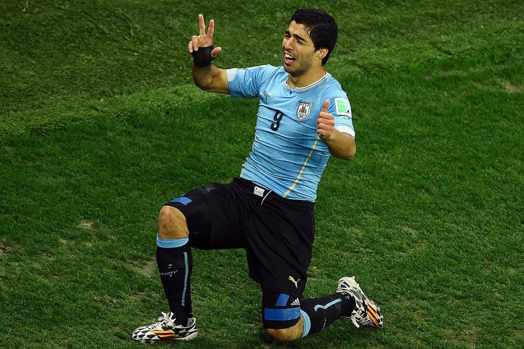 Luis Suarez of Uruguay celebrates after scoring his team's second goal during the Group D match between Uruguay and England.
