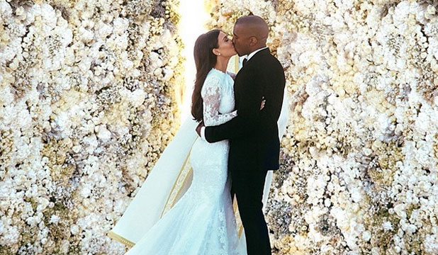 Forcing It Kim And Kanye Spent Days Touching Up Their Official Kissing Shot To Make