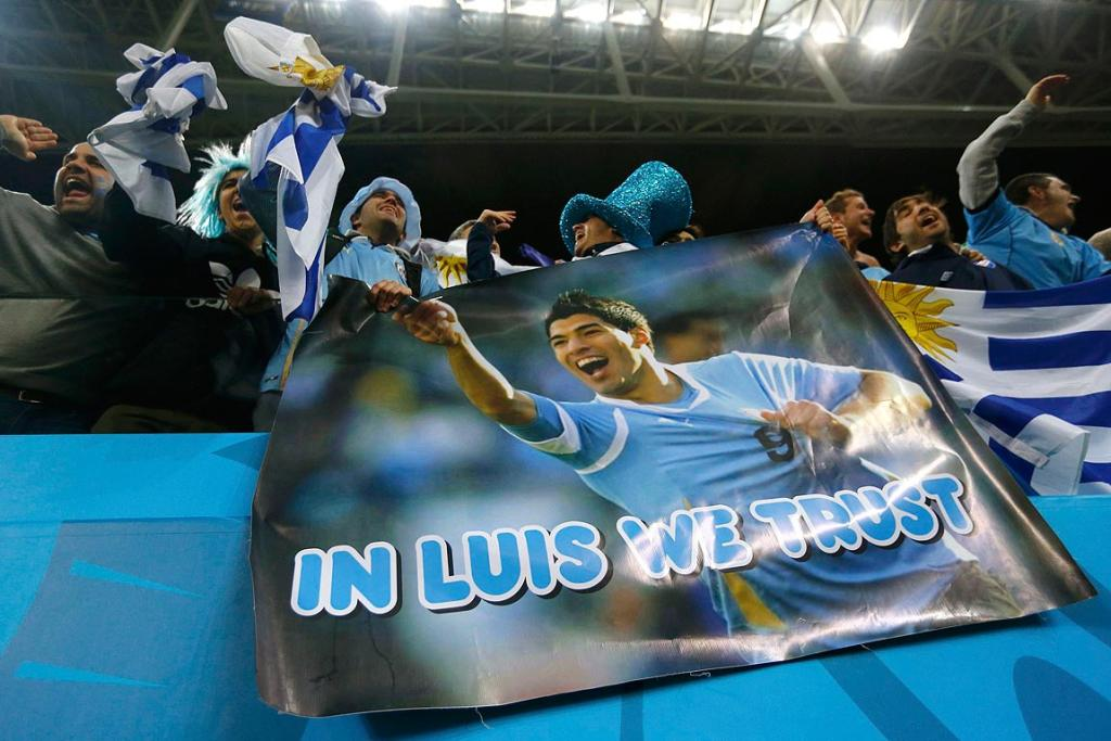 Uruguay fans celebrate with a poster of Luis Suarez after the Group D match between Uruguay and England.