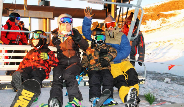 Cardrona Groms team members Campbell Melville-Ives (left) and Finley Melville-Ives (third left), seven-year-old twins from Wanaka, catch the first chairlift of the snow season with parents Karen and Neil at Cardrona Alpine Resort.