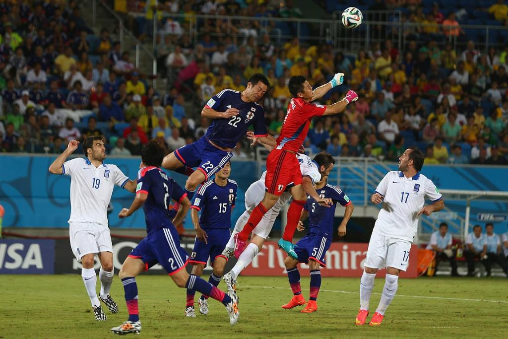 Eiji Kawashima of Japan punches clear during the 2Group C match between Japan and Greece.