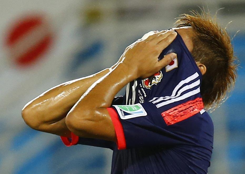 Japan's Yoshito Okubo reacts after missing a chance to score a goal during their Group C match against Greece.