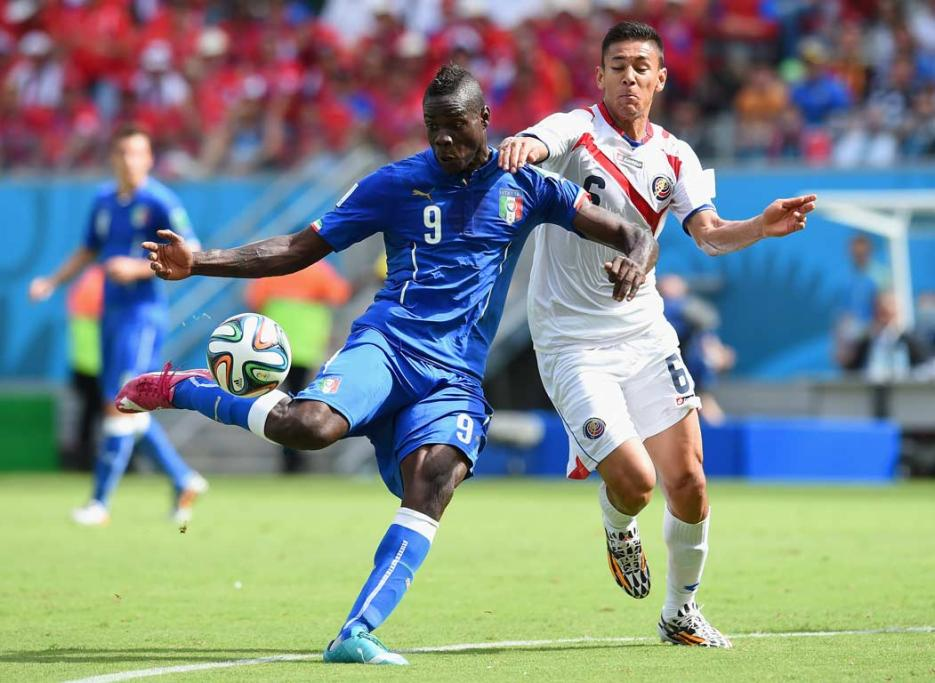 Italy's Mario Balotelli takes a shot at goal under Costa Rican pressure.