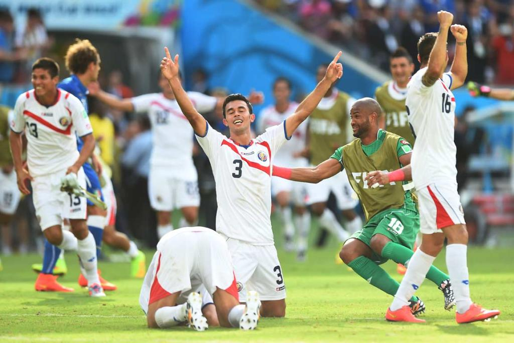 Giancarlo Gonzalez and Costa Rican team-mates celebrate their progression through to the second stage.