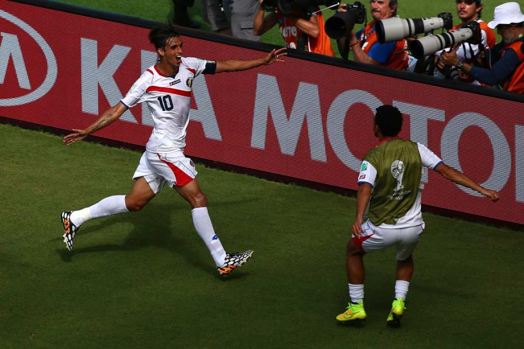 Bryan Ruiz celebrates with a Costa Rican substitute after his goal against Italy.