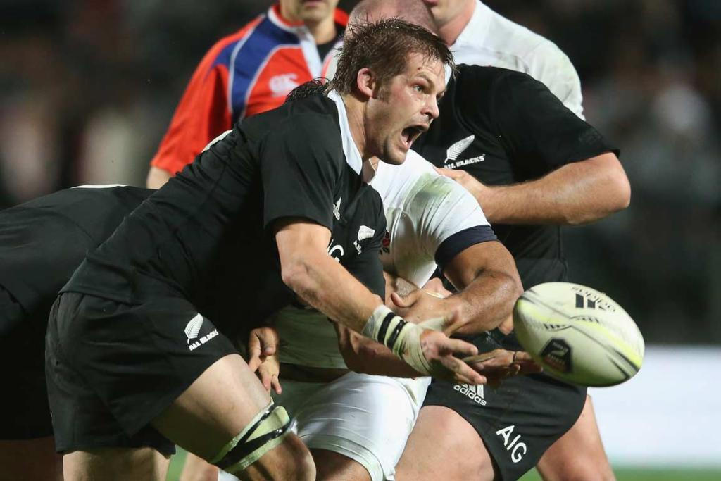 Richie McCaw clears the ball from the back of a maul.