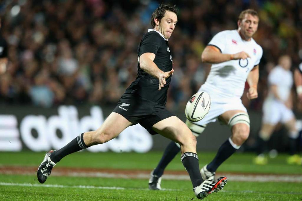 Ben Smith makes a clearing kick from All Blacks' territory.