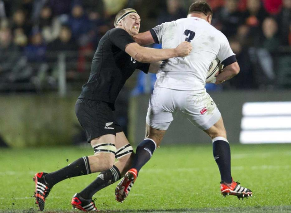 All Blacks lock Brodie Retallick attempts to tackle English prop David Wilson.