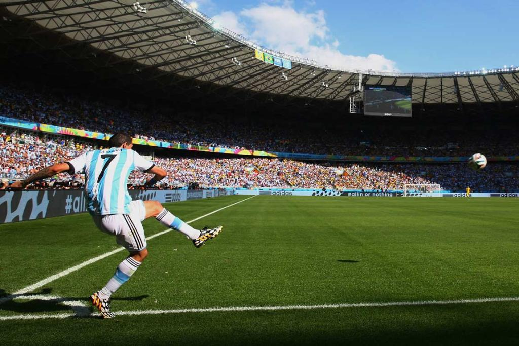 Argentina's Angel di Maria takes a corner kick against Iran.