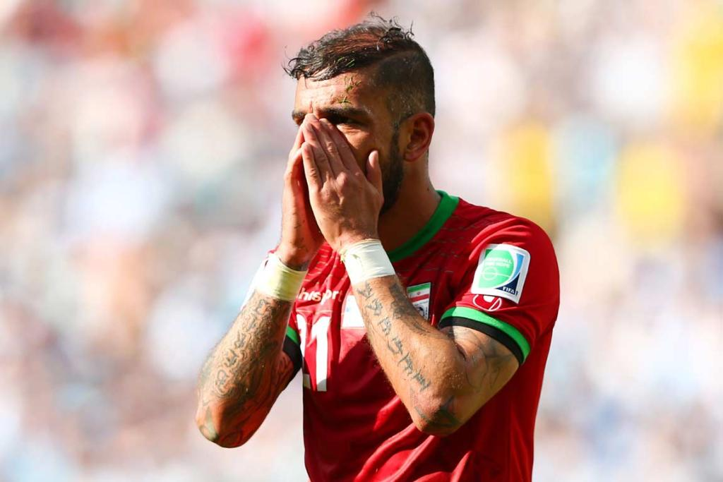 Iran's Ashkan Dejagah reacts after missing a scoring chance.