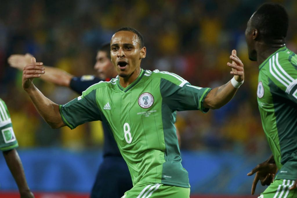 Nigeria's Peter Odemwingie celebrates scoring his goal against Bosnia at the Pantanal Arena in Cuiaba.