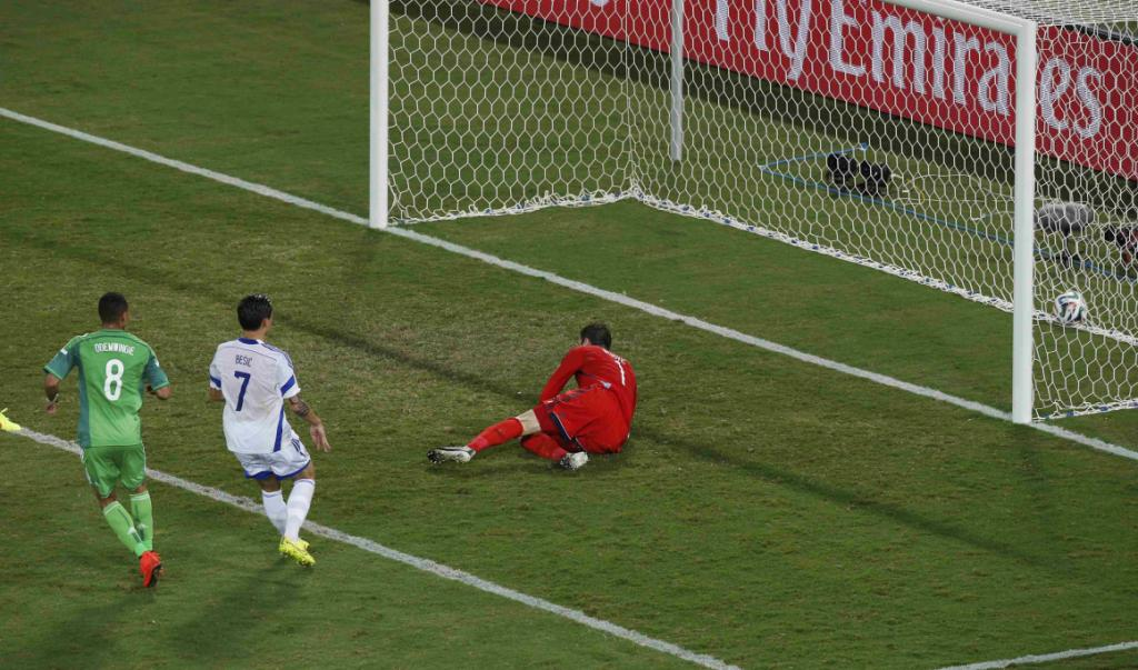 Nigeria's Peter Odemwingie scores past Bosnia and Herzegovina goalkeeper and club team-mate Asmir Begovic.