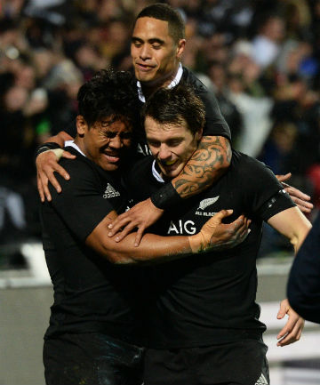 UNSTOPPABLE: All Black wing Julian Savea celebrates one of his three tries with team-mates Aaron and Ben Smith.
