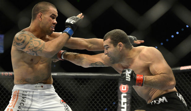 BODY BLOW: Kiwi James Te Huna exchanges blows with Brazil's Shogun Rua during their heavyweight fight in Brisbane last year.